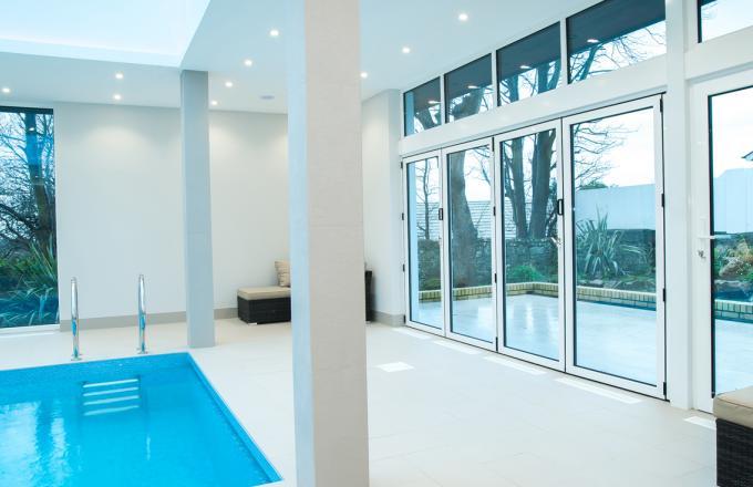 white bi fold doors for swimming pool from Woodstock