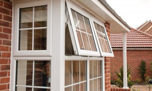 White over hanging upvc windows