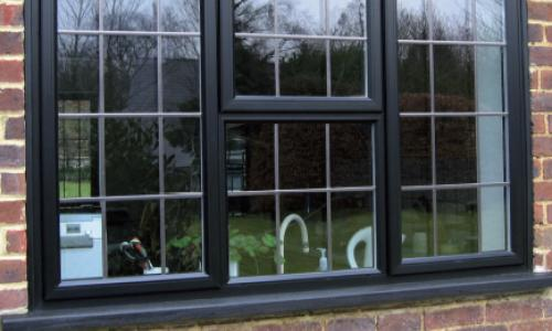 Black framed window with lead panes