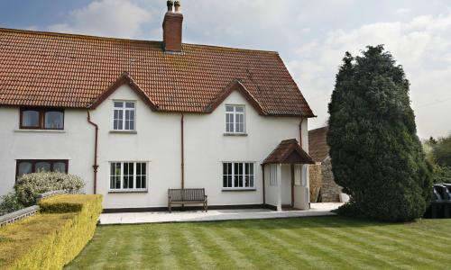 semi detached cottage with casement windows