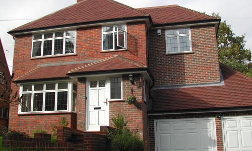 casement windows on a red house